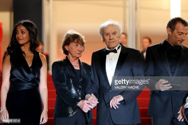 French actress Nabiha Akkari French actor JeanLouis Trintignant and his wife Marianne Hoepfner and French actor Mathieu Kassovitz pose as they arrive...