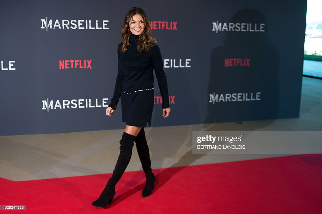 French actress Nadia Fares poses during a photocall for the premiere of the French TV show 'Marseille' broadcasted and co-produced by Netflix on May 4, 2016 in Marseille, southern France. / AFP / BERTRAND