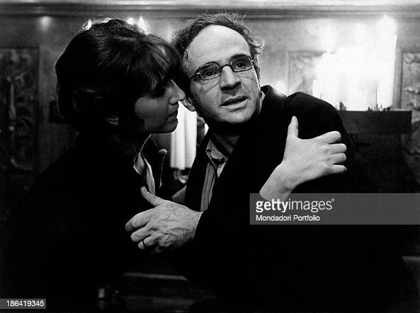 French actress Nathalie Baye hugging French director and actor Francois Truffaut in the film The Green Room 1978