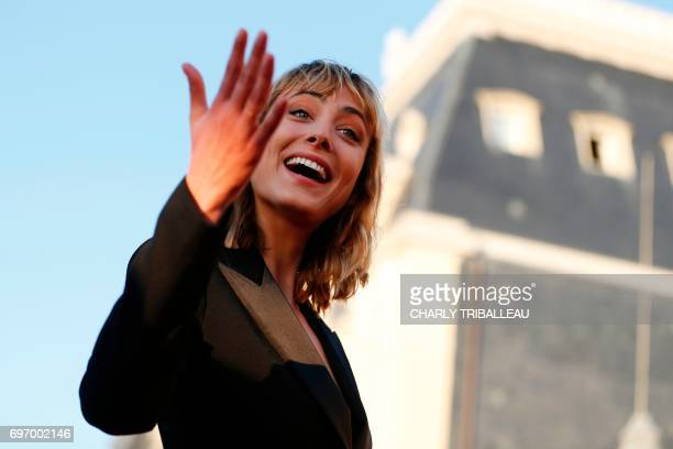 French actress Nora Arnezeder gestures as she poses on the red carpet on June 17 2017 during the Cabourg Romantic Film Festival in Cabourg...