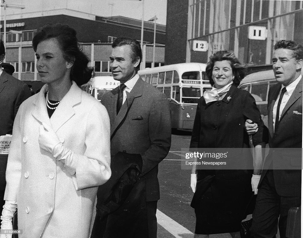 French actress Odile Rodin (left) and her husband Dominican diplomat and socialite <a gi-track='captionPersonalityLinkClicked' href=/galleries/search?phrase=Porfirio+Rubirosa&family=editorial&specificpeople=227966 ng-click='$event.stopPropagation()'>Porfirio Rubirosa</a> (1909 - 1965) (second left), and Kennedy heir Patricia Kennedy (1924 - 2006) and her husband British-born American actor <a gi-track='captionPersonalityLinkClicked' href=/galleries/search?phrase=Peter+Lawford&family=editorial&specificpeople=85811 ng-click='$event.stopPropagation()'>Peter Lawford</a> (1923 - 1984) leave an airport, having flown to England for the premiere of Otto Preminger's film of 'Exodus,' England, September 5, 1961.