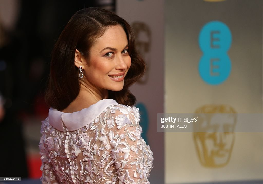 French actress Olga Kurylenko poses on arrival for the BAFTA British Academy Film Awards at the Royal Opera House in London on February 14, 2016. TALLIS