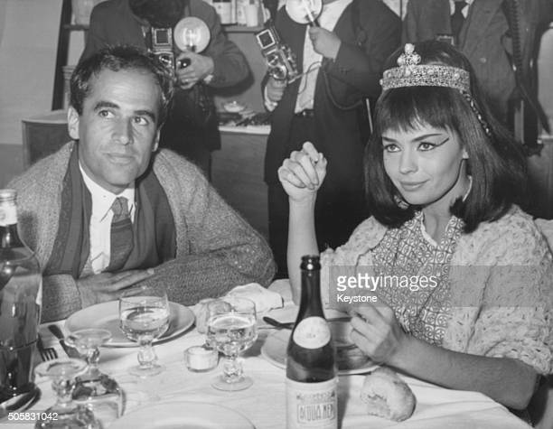 French actress Pascale Petit in costume as Cleopatra eating lunch with her husband Giani Esposito during a break in filming 'A Queen for Caesar' at...