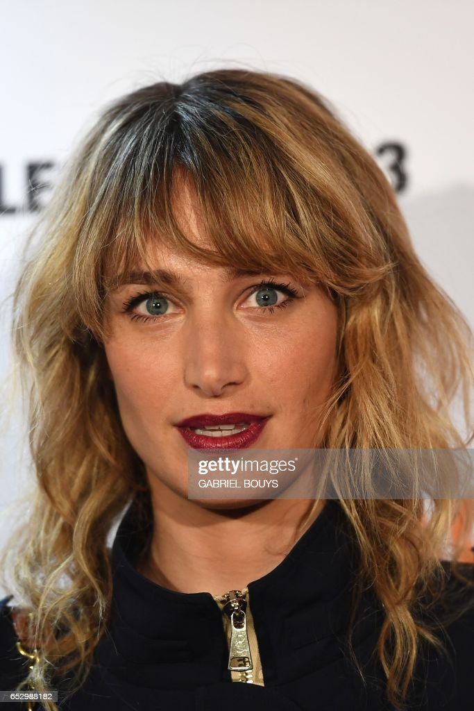 French actress Pauline Lefevre poses during the photocall for the premiere of the film 'Chacun Sa Vie' in Paris on March 13, 2017. The film is directed by French director Claude Lelouch