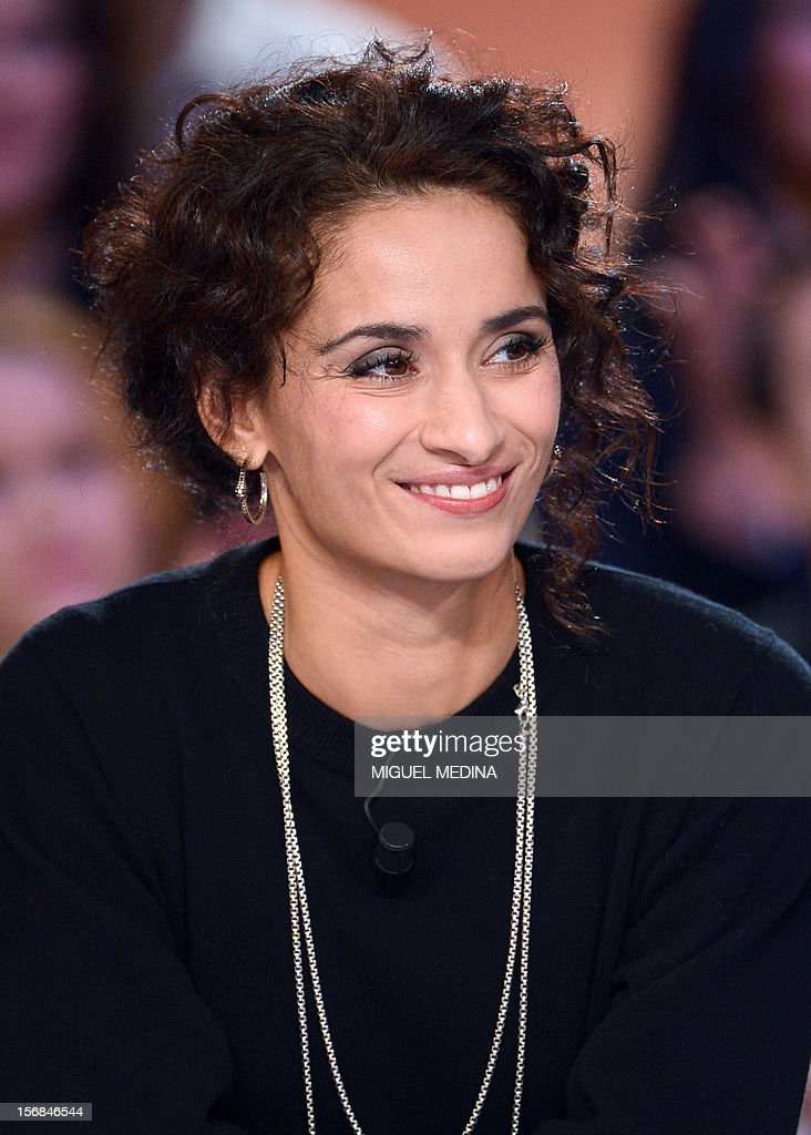 French actress Rachida Brakni takes part in the TV show 'Le grand journal' host by her husband former French football player turned actor Eric Cantona, on a set of French TV Canal+, on November 22, 2012 in Paris, as part of the launching of French charity association Abbe Pierre Foundation's winter campaign. AFP PHOTO MIGUEL MEDINA