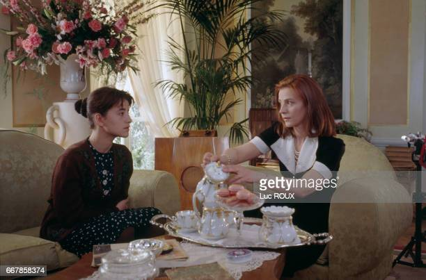 French actress Romane Bohringer and Russian actress Yelena Safonova on the set of the film L'Accompagnatrice written and directed by Claude Miller