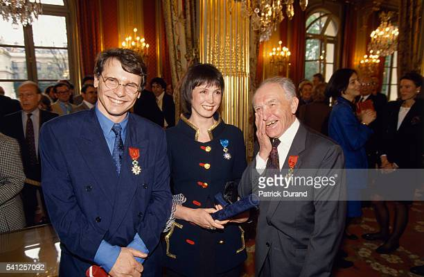 French actress Sabine Azema and photographer Robert Doisneau smile after receiving the 'Legion d'Honneur' award from French President