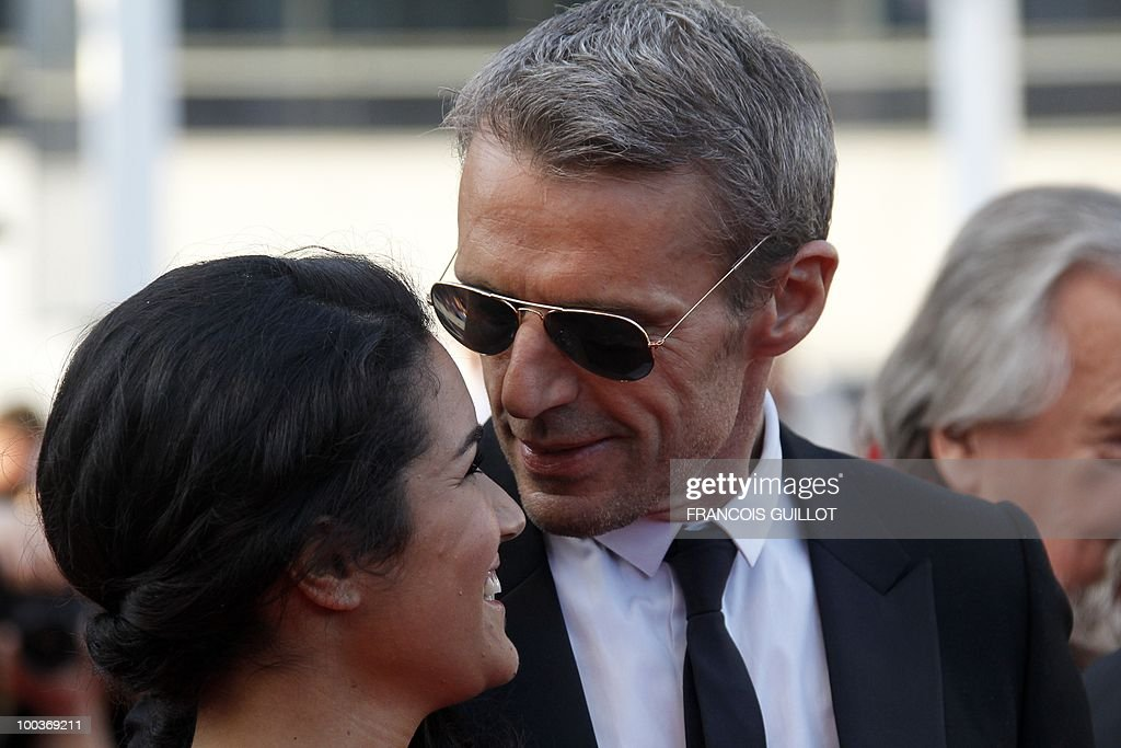 French actress Sabrina Ouazani and French actor Lambert Wilson arrive for the screening of 'Des Hommes et des Dieux' (Of God and Men) presented in competition at the 63rd Cannes Film Festival on May 18, 2010 in Cannes.