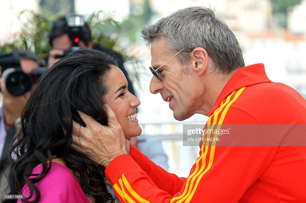 French actress Sabrina Ouazani and French actor Lambert Wilson pose during the photocall of 'Des Hommes et des Dieux' (Of God and Men) presented in competition at the 63rd Cannes Film Festival on May 18, 2010 in Cannes.