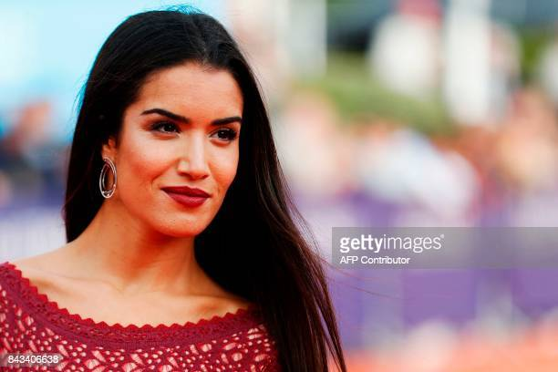 French actress Sabrina Ouazani poses on the red carper before the screening of 'The music of silence' on September 6 2017 in the northwestern sea...