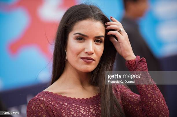 French actress Sabrina Ouazani poses on the red carpet before the screening of the movie 'The Music Of Silence' during the 43rd Deauville American...