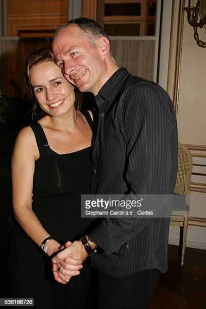 French actress Sandrine Bonnaire and her husband Guillaume Laurent pose for a photocall during the 18th edition of Cabourg's 'Romantic Days' film...