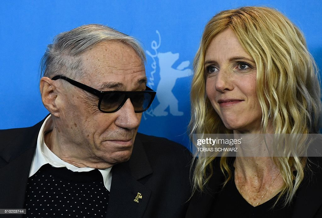 French actress Sandrine Kiberlain (R) and French director Andre Techine pose during a photo call for the film 'Quand on a 17 Ans' (Being 17) by Andre Techine in competition at the 66th Berlinale Film Festival in Berlin on February 14, 2016. / AFP / TOBIAS SCHWARZ
