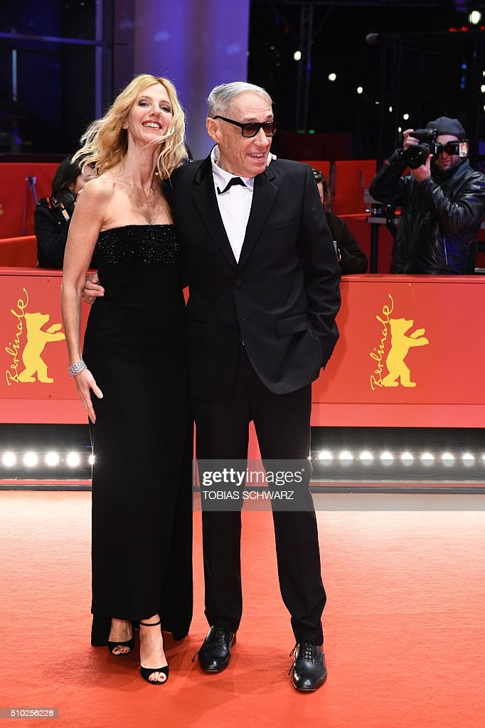 French actress Sandrine Kiberlain (L) and French director Andre Techine arrive on the red carpet for the film 'Quand on a 17 Ans' (Being 17) by Andre Techine in competition at the 66th Berlinale Film Festival in Berlin on February 14, 2016. / AFP / TOBIAS SCHWARZ