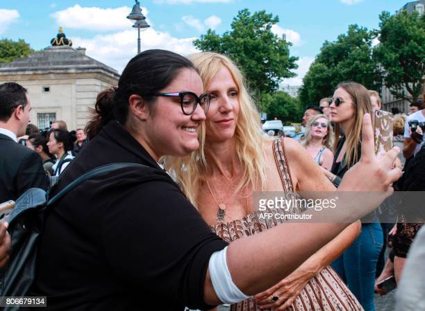 French actress Sandrine Kiberlain arrives before Christian Dior 2017 fall/winter Haute Couture collection show in Paris on July 3 2017 / AFP PHOTO /