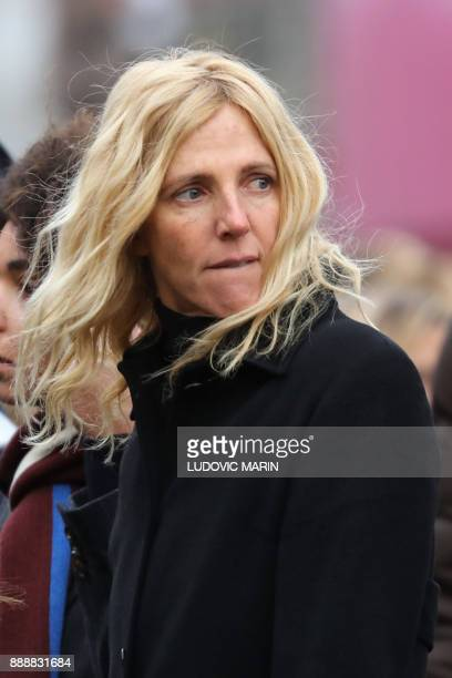 French actress Sandrine Kiberlain leaves the La Madeleine Church at the end of the funeral ceremony in tribute to late French singer Johnny Hallyday...