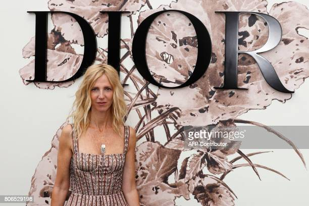 French actress Sandrine Kiberlain poses during the photocall before Christian Dior 2017 fall/winter Haute Couture collection show in Paris on July 3...