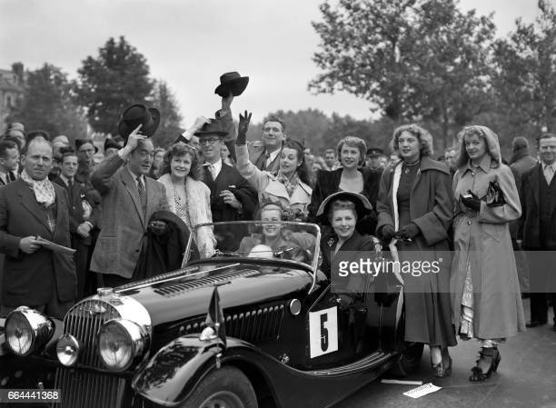 French actress Simone Renant poses in a car during an elegance contest in Paris in 1948 / AFP PHOTO /