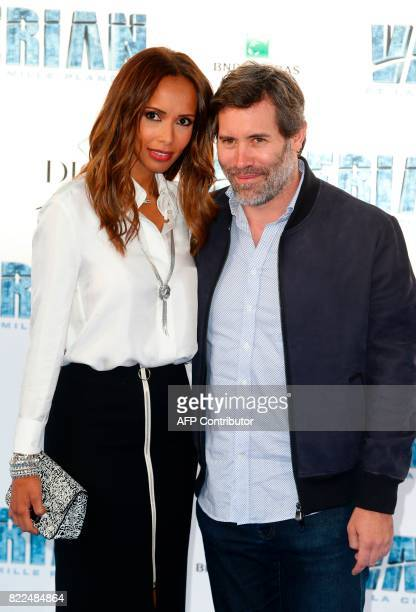 French actress Sonia Rolland and her husband French actor Jalil Lespert pose for a photograph upon arrival for the prepremiere of the film 'Valerian...