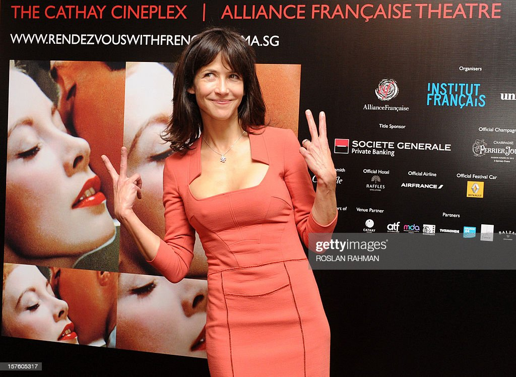 French actress Sophie Marceau gestures at a media conference to promote her new movie 'Happiness Never Comes Alone' as part of the French Film Festival in Singapore on December 5, 2012. French film 'Happiness Never Comes Alone' (Un bonheur n'arrive jamais seul), directed by James Huth, makes its Southeast Asian debut with its star Sophie Marceau will have its premier screening at The Cathay in Singapore.