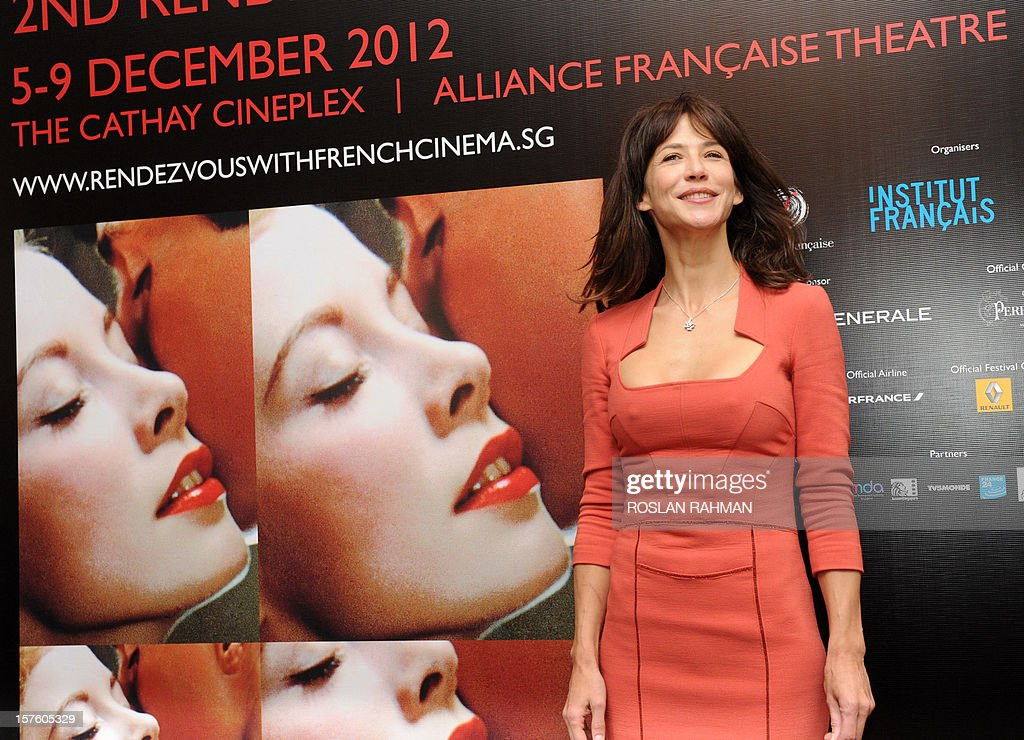 French actress Sophie Marceau poses at a media conference to promote her new movie 'Happiness Never Comes Alone' as part of the French Film Festival in Singapore on December 5, 2012. French film 'Happiness Never Comes Alone' (Un bonheur n'arrive jamais seul), directed by James Huth, makes its Southeast Asian debut with its star Sophie Marceau will have its premier screening at The Cathay in Singapore.