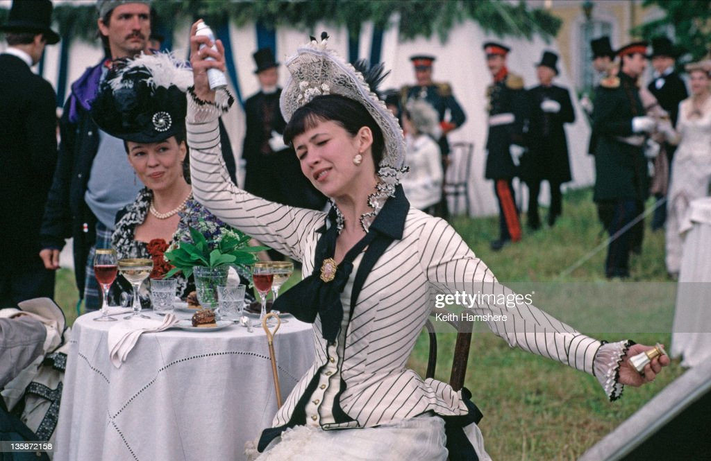 French actress <a gi-track='captionPersonalityLinkClicked' href=/galleries/search?phrase=Sophie+Marceau&family=editorial&specificpeople=220531 ng-click='$event.stopPropagation()'>Sophie Marceau</a> spritzes herself with an aerosol can before a scene in the film 'Leo Tolstoy's Anna Karenina', 1997. The movie was filmed on location in Russia.