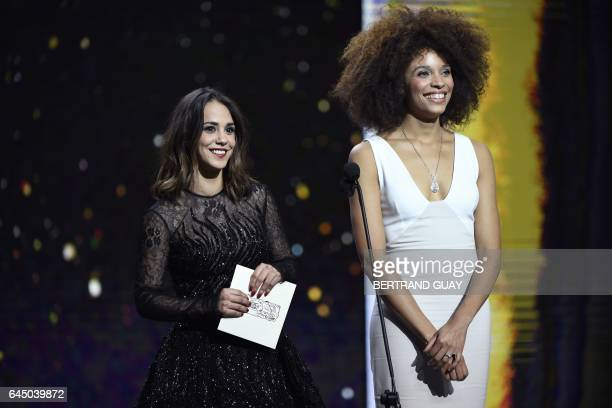 French actress Stefi Celma and French actress Alice Belaidi speak on stage during the 42nd edition of the Cesar Ceremony at the Salle Pleyel in Paris...