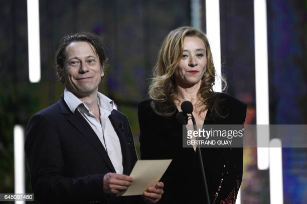 French actress Sylvie Testud and French actor Mathieu Amalric speak during the 42nd edition of the Cesar Ceremony at the Salle Pleyel in Paris on...