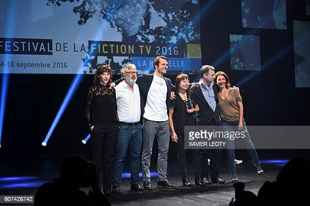 French actress Valerie Karsenti and team members of the TV film 'Tuer un homme' pose after receiving the best serie 52' award during the closing...
