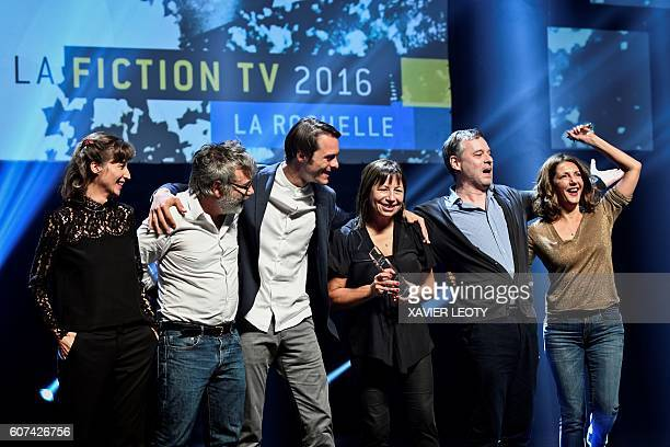 French actress Valerie Karsenti and team members of the TV film 'Tuer un homme' celebrate after receiving the best serie 52' award during the closing...