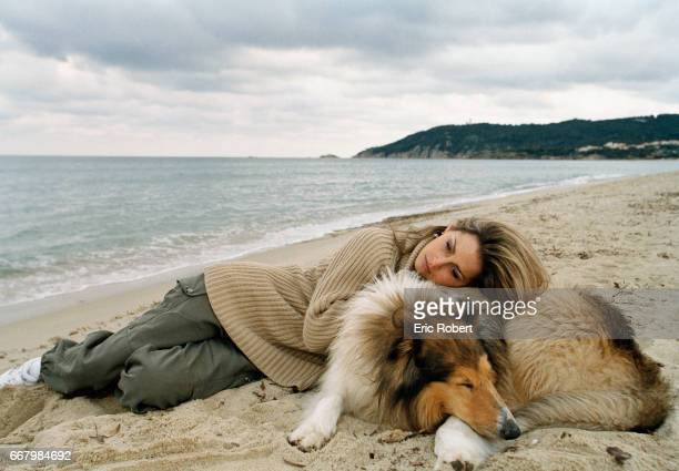French actress Vanessa Wagner relaxes on the beach in Saint Tropez with her collie She starred in the French films Le Bal du Gouverneur and Louis...