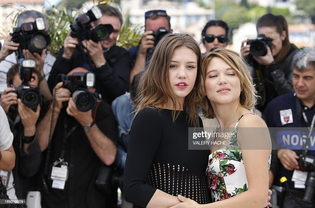 French actresses Adele Exarchopoulos (L) and Lea Seydoux pose on May 23, 2013 during a photocall for the film 'Blue is the Warmest Colour' (La Vie d'Adele - Chapitre 1 & 2) presented in Competition at the 66th edition of the Cannes Film Festival in Cannes. Cannes, one of the world's top film festivals, opened on May 15 and will climax on May 26 with awards selected by a jury headed this year by Hollywood legend Steven Spielberg.