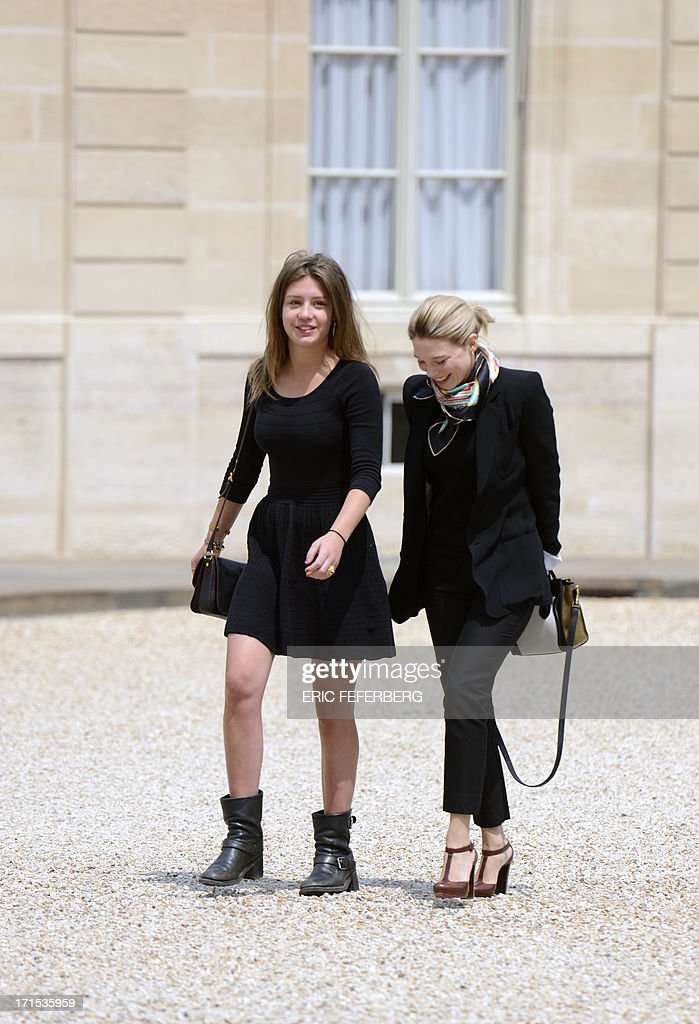 French actresses Adele Exarchopoulos (L) and Lea Seydoux, winners of the Palme d'Or at the Cannes film festival 2013, arrive for a lunch with the French President at the Elysee Presidential palace in Paris.