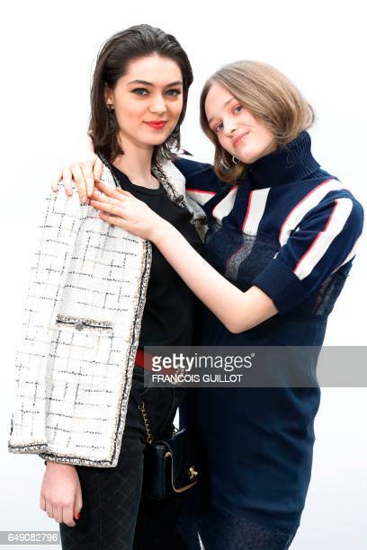 French actresses Anamaria Vartolomei and Lily Taieb pose during the photocall before the Chanel women's FallWinter readytowear collection fashion...