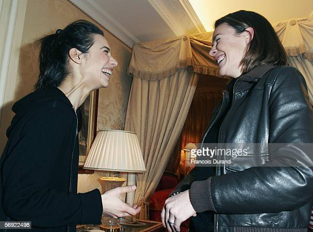 French actresses Benedicte Delmas and Marie Fugain pose for photographs inside the 'Espace Glamour Chic' the first gift lounge organized at the...