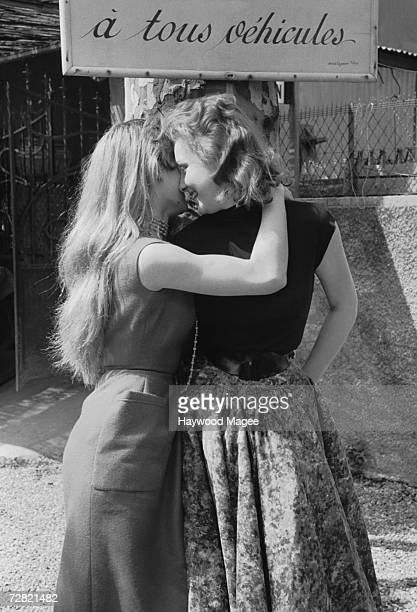French actresses Brigitte Bardot and Isabelle Corey at the Cannes Film Festival 12th May 1956 Original Publication Picture Post 8378 Discovery At...