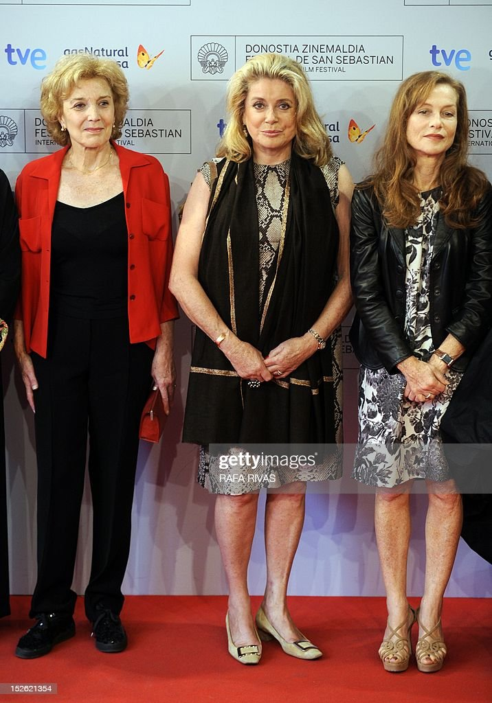 French actresses Catherine Deneuve (C) and Isabelle Huppert (R), and Spanish actress Marisa Paredes pose prior to attending the screening of their film 'As Linhas de Torres' (Lines of Wellington), during the 60th San Sebastian International Film Festival, on September 23, 2012, in the northern Spanish Basque city of San Sebastian.