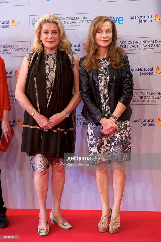 French actresses Catherine Deneuve (L) and Isabelle Huppert (R) attend the 'As Linhas De Torres' photocall at the Kursaal Palace during the 60th San Sebastian International Film Festival on September 23, 2012 in San Sebastian, Spain.