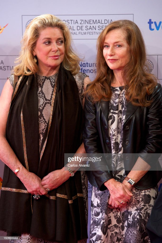 French actresses <a gi-track='captionPersonalityLinkClicked' href=/galleries/search?phrase=Catherine+Deneuve&family=editorial&specificpeople=123833 ng-click='$event.stopPropagation()'>Catherine Deneuve</a> (L) and <a gi-track='captionPersonalityLinkClicked' href=/galleries/search?phrase=Isabelle+Huppert&family=editorial&specificpeople=662796 ng-click='$event.stopPropagation()'>Isabelle Huppert</a> (R) attend the 'As Linhas De Torres' photocall at the Kursaal Palace during the 60th San Sebastian International Film Festival on September 23, 2012 in San Sebastian, Spain.
