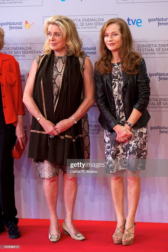 French actresses <a gi-track='captionPersonalityLinkClicked' href=/galleries/search?phrase=Catherine+Deneuve&family=editorial&specificpeople=123833 ng-click='$event.stopPropagation()'>Catherine Deneuve</a> (L) and <a gi-track='captionPersonalityLinkClicked' href=/galleries/search?phrase=Isabelle+Huppert&family=editorial&specificpeople=662796 ng-click='$event.stopPropagation()'>Isabelle Huppert</a> (R) attend the 'As Linhas De Torres photocall photocall at the Kursaal Palace during the 60th San Sebastian International Film Festival on September 23, 2012 in San Sebastian, Spain.