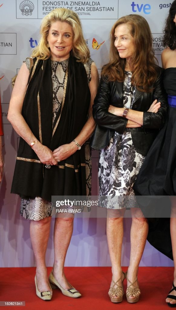 French actresses Catherine Deneuve (L) and Isabelle Huppert pose prior to attending the screening of their film 'As Linhas de Torres' (Lines of Wellington), during the 60th San Sebastian International Film Festival, on September 23, 2012, in the northern Spanish Basque city of San Sebastian.