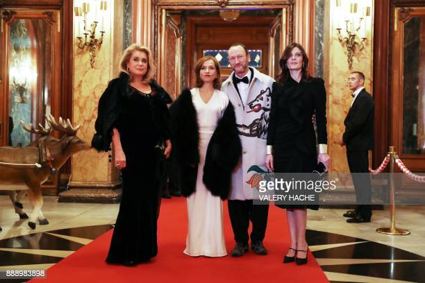 French actresses Catherine Deneuve Isabelle Huppert and Deneuve's daughter Chiara Mastroianni pose with Belgian artist and designer Charles Kaisin as...