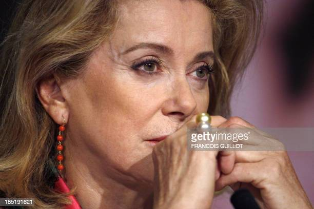 French actresses Catherine Deneuve listens to questions during a press conference after a photocall for her film 'A Christmas Tale' at the 61st...