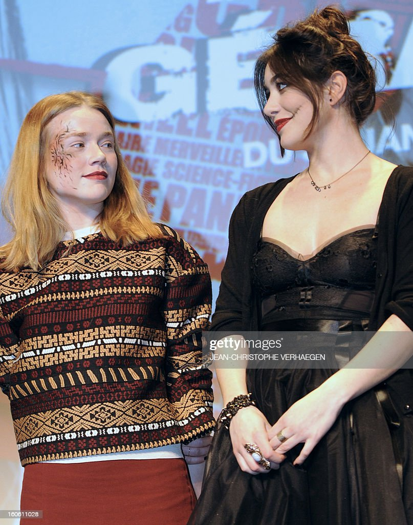 French actresses Jemina West (L) and Fanny Vallette, members of the short film jury, wear a scary make-up as they attend the closing ceremony of the 20th International Fantastic Film Festival on February 3, 2013 in Gerardmer, eastern France. AFP PHOTO / JEAN-CHRISTOPHE VERHAEGEN