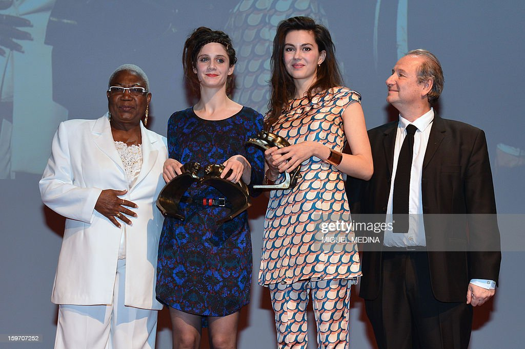 French actresses Julia Faure (2ndR) and Judith Chemla (2ndL) pose next to actors Firmine Richard (L) and Patrick Braoude (R) after receiving the most promising actress award during the 18th Lumieres awards ceremony, on January 18, 2013 at the Gaite Lyrique in Paris. International media journalists based in Paris from around 50 countries vote each year to award their own prizes to members of the French and francophone film industry. The Academy of the Lumieres paid this year a tribute to foreign actresses in French cinema and organised for the first time, the day before, the 'Francophone meetings' with hosted Tunisia, during which Tunisian director, Ferid Boughedir gave a masterclass. AFP PHOTO MIGUEL MEDINA