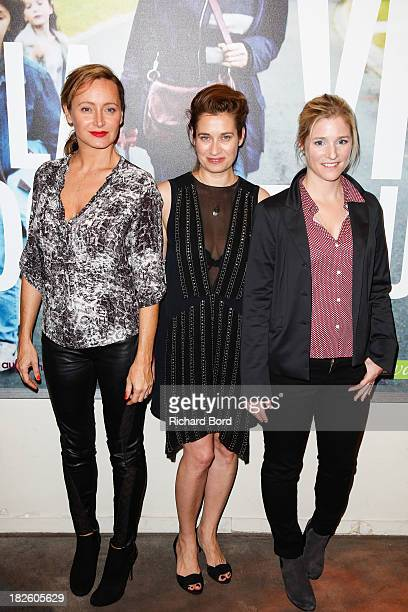 French actresses Julie Ferrier Emmanuelle Devos and Natacha Regnier attend 'La Vie Domestique' Paris premiere at MK2 Cinema on October 1 2013 in...