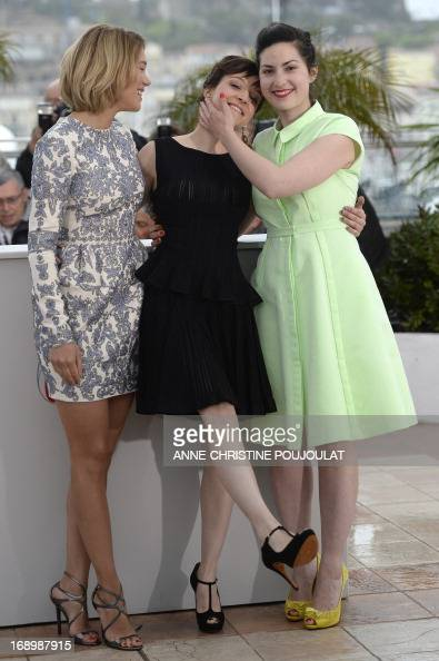 French actresses Lea Seydoux and Camille Lellouche and director Rebecca Zlotowski pose on May 18 2013 during a photocall for the film 'Grand Central'...
