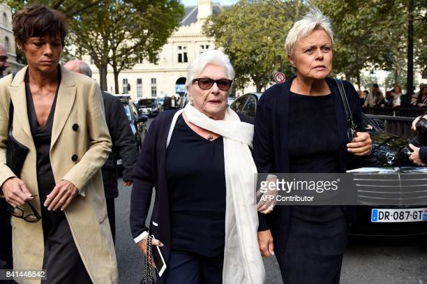 French actresses Muriel Robin her partner Anne Le Nen and Line Renaud arrive at the SaintSulpice church to attend the funeral of late actress...