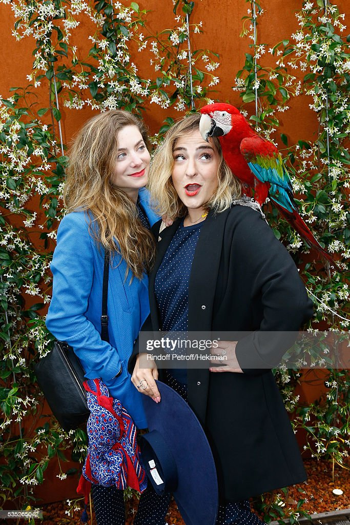 French actresses Sarah Suco (L) and <a gi-track='captionPersonalityLinkClicked' href=/galleries/search?phrase=Marilou+Berry&family=editorial&specificpeople=672535 ng-click='$event.stopPropagation()'>Marilou Berry</a> attend the French Tennis Open Day 8 at Roland Garros on May 29, 2016 in Paris, France.