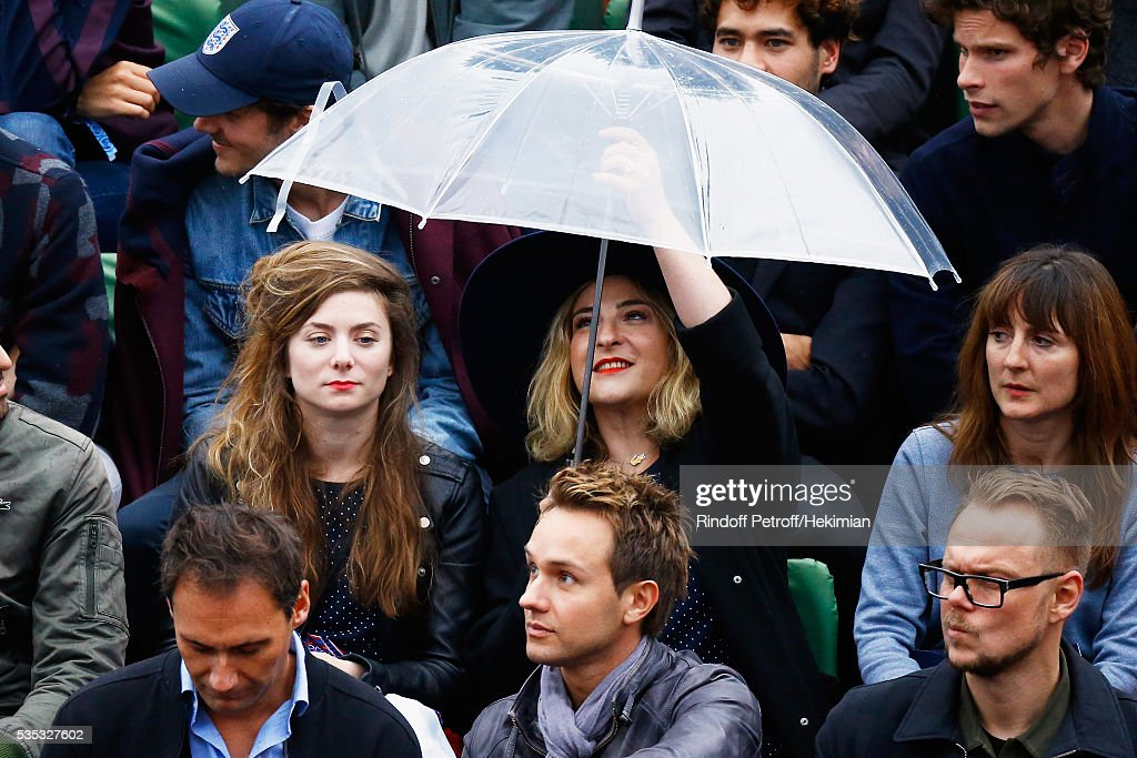 French actresses Sarah Suco (L) and Marilou Berry attend the French Tennis Open Day 8 at Roland Garros on May 29, 2016 in Paris, France.